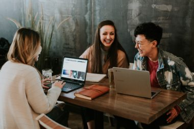 Group of laughing women at a business meeting